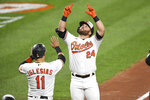 Baltimore Orioles' DJ Stewart (24) celebrates his home run with teammate Jose Iglesias (11) during the third inning of a baseball game against the Atlanta Braves, Monday, Sept. 14, 2020, in Baltimore. (AP Photo/Terrance Williams)