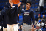 Connecticut's James Bouknight, right, watches his team warm up before an exhibition NCAA college basketball game against Saint Michael's, Wednesday, Oct. 30, 2019, in Hartford, Conn. (AP Photo/Jessica Hill)
