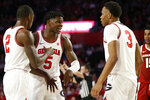 Georgia's Anthony Edwards (5) speaks with Jordan Harris (2) and Christian Brown (3) during the team's NCAA college basketball against Arkansas in Athens, Ga., Saturday, Feb. 29, 2020. Georgia won 99-89. (Joshua L. Jones/Athens Banner-Herald via AP)
