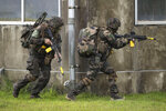French army soldiers take part in a joint military drill between Japan Self-Defense Force, French army and U.S. Marines, at the Kirishima exercise area in Ebino, Miyazaki prefecture, southern Japan Saturday, May 15, 2021. (Charly Triballeau/Pool Photo via AP)
