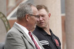 Nebraska Athletic Director Bill Moos, left, sits with football coach Scott Frost during an NCAA college football news conference, Friday, Sept. 27, 2019, in Lincoln, Neb., announcing a new planned $150 million football training facility adjacent to Memorial Stadium. (AP Photo/Nati Harnik)