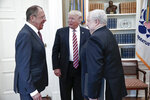 FILE - In this image provided by the Russian Foreign Ministry, President Donald Trump meets with Russian Foreign Minister Sergey Lavrov, left, next to Russian Ambassador to the U.S. Sergei Kislyak at the White House in Washington, on May 10, 2017. (Russian Foreign Ministry Photo via AP)