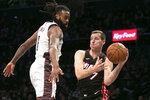 Brooklyn Nets center DeAndre Jordan (6), left, tries to block a pass by Miami Heat guard Goran Dragic (7) in the first half of an NBA basketball game, Sunday, Dec. 1, 2019 in New York. (AP Photo/Mark Lennihan)