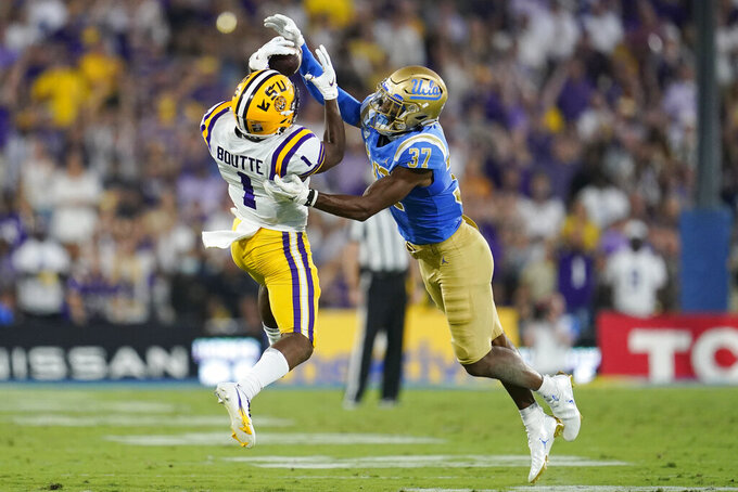 UCLA defensive back Quentin Lake (37) breaks up a pass intended for LSU wide receiver Kayshon Boutte (1) during the first half of an NCAA college football game Saturday, Sept. 4, 2021, in Pasadena, Calif. (AP Photo/Marcio Jose Sanchez)