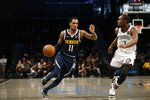 Denver Nuggets guard Monte Morris (11) moves the ball against Brooklyn Nets guard Theo Pinson (1) during the first half of an NBA basketball game on Sunday, Dec. 8, 2019, in New York. (AP Photo/Nicole Sweet)