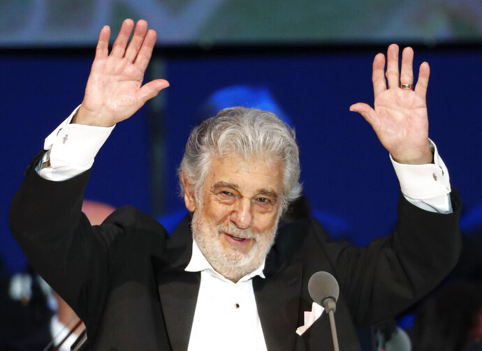 "FILE - In this Aug. 28, 2019, file photo, Opera star Placido Domingo performs during a concert in Szeged, Hungary. The 78-year-old singer who rose to stardom as a tenor has been confirmed to sing the baritone title role in ""Nabucco"" at the Zurich Opera House this Sunday. It will be his first time performing since stepping down Oct. 2 as general director of the Los Angeles Opera and withdrawing from future performances at the company.(AP Photo/Laszlo Balogh, File)"