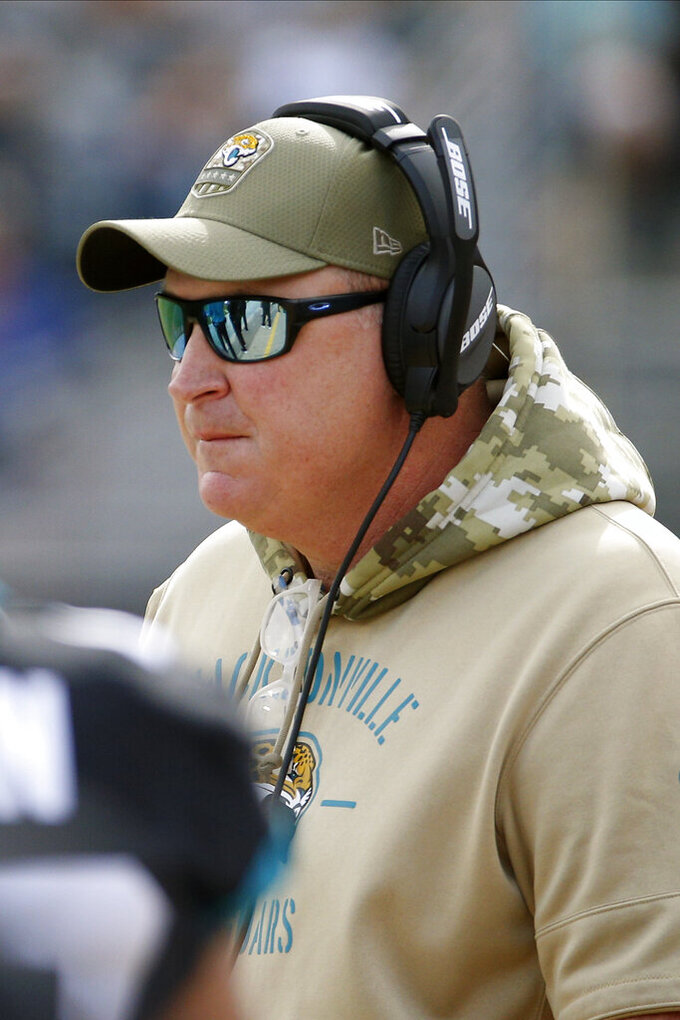 Jacksonville Jaguars head coach Doug Marrone watches play during the first half of an NFL football game against the Tampa Bay Buccaneers, Sunday, Dec. 1, 2019, in Jacksonville, Fla. (AP Photo/Stephen B. Morton)