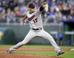 Minnesota Twins starting pitcher Jose Berrios, delivers to a Kansas City Royals batter during the first inning of a baseball game at Kauffman Stadium in Kansas City, Mo., Tuesday, April 2, 2019. (AP Photo/Orlin Wagner)