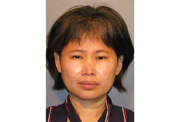 This booking photo provided by Caddo Parish office shows Trina Chu. A judicial candidate in Louisiana, Chu is accused of sending a friend confidential court documents while she was a law clerk for the same court's chief judge. The Caddo Parish Sheriff's Office says  Chu was arrested Tuesday, Aug. 4, 2020, on two felony charges: offense against intellectual property and trespass against state computers.  (Caddo Parish office via AP)