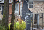 Authorities investigate the scene where an airplane crashed into a multi-unit townhome, Wednesday, Oct. 30, 2019, in Atlanta. (AP Photo/David Goldman)