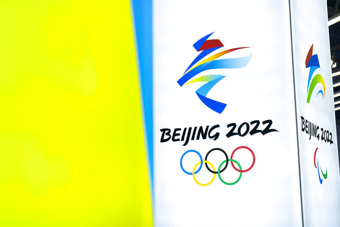 """FILE - In this Feb. 5, 2021, file photo, the logos for the 2022 Beijing Winter Olympics and Paralympics are seen during an exhibit at a visitors center at the Winter Olympic venues in Yanqing on the outskirts of Beijing. China on Thursday, July 8, 2021, criticized what it called the """"politicization of sports"""" after British lawmakers urged a boycott of the 2022 Beijing Winter Olympics unless China allows an investigation of complaints of human rights abuses in its northwest.(AP Photo/Mark Schiefelbein, File)"""