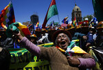 A female supporter of Bolivian President Evo Morales shows her support during a march in La Paz, Bolivia, Wednesday, Oct. 23, 2019. Morales said his opponents are trying to stage a coup against him as protests grow over a disputed election he claims he won outright. (AP Photo/Juan Karita)