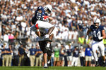 Penn State wide receiver Cam Sullivan-Brown (6) catches a pass against Ball State linebacker Clayton Coll (32) during an NCAA college football game in State College, Pa., Saturday, Sept. 11, 2021. (AP Photo/Barry Reeger)