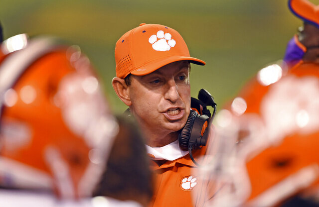Clemson coach Dabo Swinney talks with players after a defensive stop against Wake Forest during an NCAA college football game Saturday, Sept. 12, 2020, in Winston-Salem, N.C. (Walt Unks/The Winston-Salem Journal via AP)