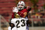 Colorado safety Isaiah Lewis (23) breaks up a pass intended for Stanford wide receiver Simi Fehoko, top, during the first half of an NCAA college football game in Stanford, Calif., Saturday, Nov. 14, 2020. (AP Photo/Jeff Chiu)