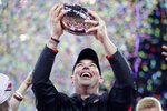 FILE - In this early Sunday, Dec. 8, 2019, file photo, Ohio State coach Ryan Day holds the trophy following the team's 34-21 win over Wisconsin in the Big Ten conference championship NCAA college football game in Indianapolis. A year ago, Day was a relatively unknown Ohio State assistant. This December he's reigning Big Ten coach of the year and is eyeing a national title after leading the Buckeyes to a 13-0 record as the successor to the retiring Urban Meyer. (AP Photo/Michael Conroy, File)