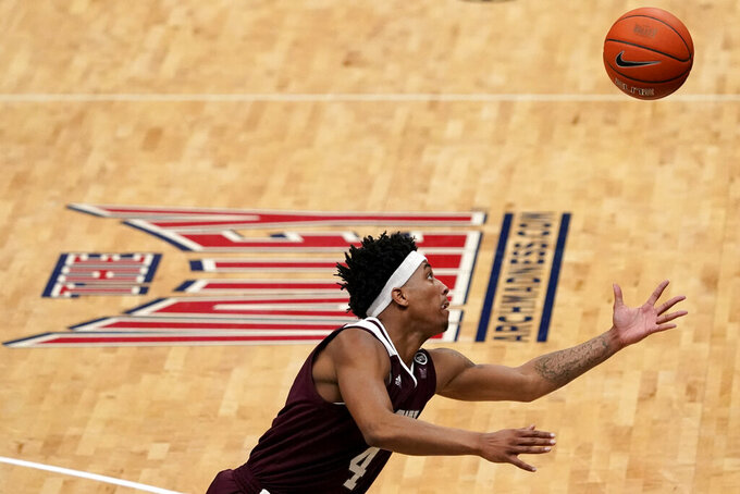 Missouri State's Ja'Monta Black reaches for a loose ball during the second half of an NCAA college basketball game against Drake in the semifinal round of the Missouri Valley Conference men's tournament Saturday, March 6, 2021, in St. Louis. (AP Photo/Jeff Roberson)