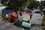 Roadblocks set up by anti-government protesters block a street in the Cotiza neighborhood during clashes with security forces as some residents show support for a mutiny by a National Guard unit in Caracas, Venezuela, Monday, Jan. 21, 2019. Venezuela's government said Monday it put down the mutiny. (AP Photo/Fernando Llano)