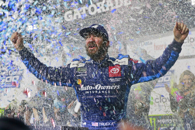 Martin Truex Jr. celebrates after winning a NASCAR Cup Series race at Martinsville Speedway in Martinsville, Va., Sunday, Oct. 27, 2019. (AP Photo/Steve Helber)