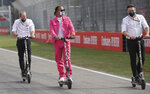 Mercedes driver Lewis Hamilton of Britain, center, rides an electric scooter with his crew during a track inspection ahead of Sunday's Emilia Romagna Formula One Grand Prix, at the Dino and Enzo Ferrari racetrack, in Imola, Italy, Friday, Oct. 30, 2020. (AP Photo/Luca Bruno)