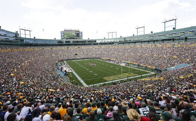 FILE - In this Sept. 24, 2017, file photo, Lambeau Field is seen during the first half of an NFL football game between the Green Bay Packers and the Cincinnati Bengals, in Green Bay, Wis. Opened in 1957 and eventually named for the famed franchise's first head coach, Lambeau Field was considered the NFL's first football-specific facility. (AP Photo/Morry Gash, File)