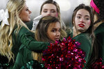 As high winds usher in freezing temperatures, Colorado State cheerleaders huddle to keep warm before the first half of an NCAA football game against Air Force Saturday, Nov. 16, 2019 in Fort Collins, Colo. (AP Photo/David Zalubowski)