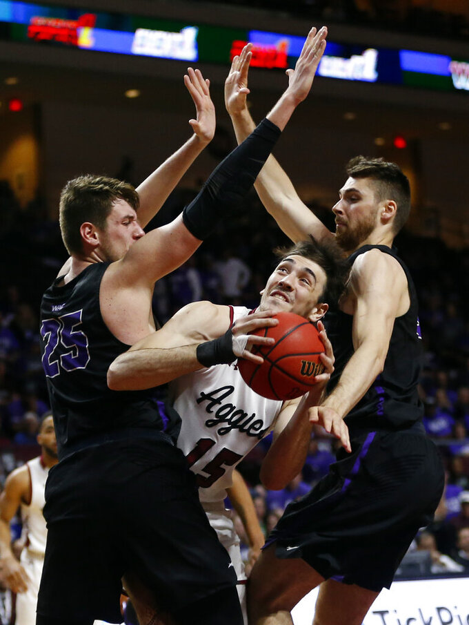 New Mexico State forward Ivan Aurrecoechea (15) looks for a shot between Grand Canyon's Alessandro Lever (25) and Matt Jackson during an NCAA college basketball game for the Western Athletic Conference men's tournament championship Saturday, March 16, 2019, in Las Vegas. New Mexico State won 89-57. (AP Photo/Steve Marcus)