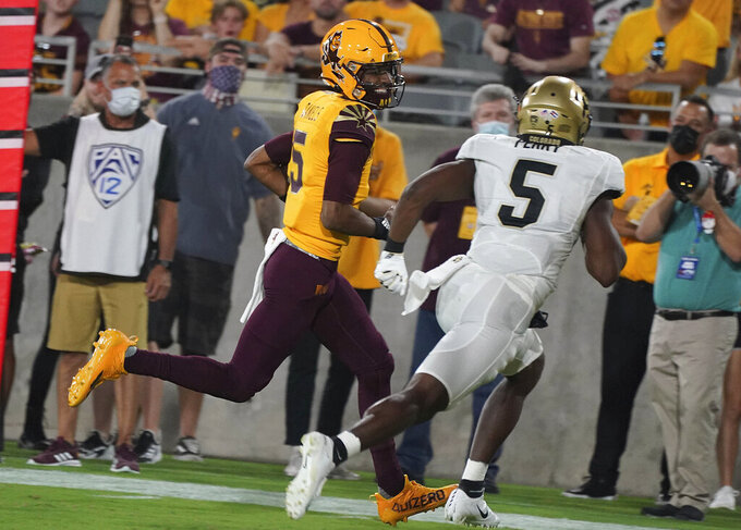 Arizona State quarterback Jayden Daniels (5) smiles at Colorado State safety Mark Perry (5) as he runs in for a touchdown during the first half of an NCAA college football game  Saturday, Sept 25, 2021, in Tempe, Ariz. (AP Photo/Darryl Webb)