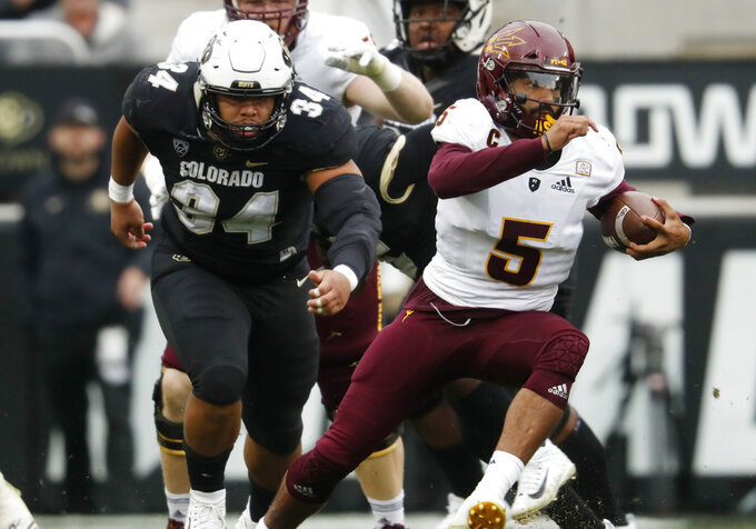 Arizona State quarterback Manny Wilkins, front, runs for yardage past Colorado defensive lineman Mustafa Johnson in the second half of an NCAA college football game Saturday, Oct. 6, 2018, in Boulder, Colo. Colorado won 28-21. (AP Photo/David Zalubowski)