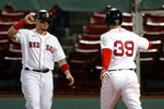 Boston Red Sox's Christian Arroyo (39) celebrates his three-run home run that also drove in Christian Vazquez, left, during the fourth inning of the team's baseball game against the New York Yankees, Friday, Sept. 18, 2020, in Boston. (AP Photo/Michael Dwyer)
