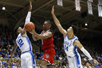 North Carolina State guard C.J. Bryce drives between Duke forward Javin DeLaurier (12) and guard Jordan Goldwire (14) during the first half of an NCAA college basketball game in Durham, N.C., Monday, March 2, 2020. (AP Photo/Gerry Broome)