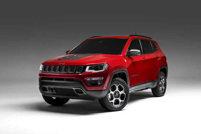This undated photo provided by Fiat Chrysler Automobiles, show the the Jeep Compass as one of three rugged vehicles along with the Renegade and the Wrangler, that will soon offer 4XE plug-in hybrid variants. (Jeep via AP)