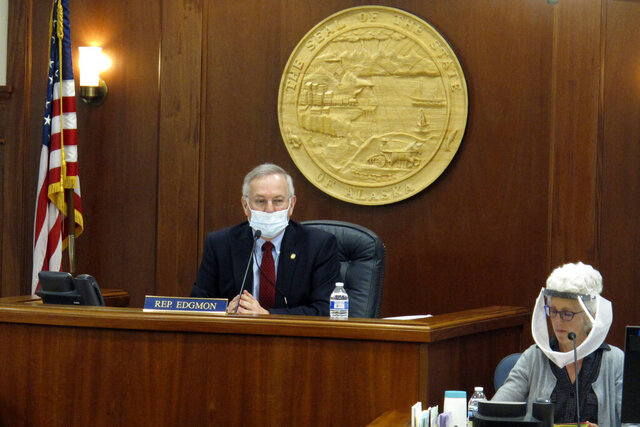 Alaska House Speaker Bryce Edgmon, left, presides over the House floor, Tuesday, May 19, 2020, in Juneau, Alaska. The House adjourned Tuesday after passing a bill ratifying plans for federal coronavirus relief aid. (AP Photo/Becky Bohrer)