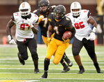 Appalachian State running back Daetrich Harrington finds a hole in the Campbell defense to break loose for a 40 yard touchdown run during the second half an NCAA college football game, Saturday, Sept. 26, 2020 at Kidd Brewer Stadium in Boone, N.C. (Walt Unks/The Winston-Salem Journal via AP)
