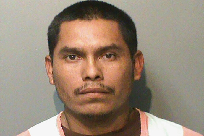This booking photo released by the Polk County, Iowa, Jail, shows Marvin Oswaldo Escobar-Orellana. Authorities say the Guatemalan man, charged with killing shooting 29-year-old Rossibeth Flores-Rodriguez, her 11-year-old daughter and 5-year-old son, had been deported twice from the U.S. and is believed to be in the country illegally. U.S. Immigration and Customs Enforcement said Wednesday night, July 17, 2019, that the 31-year-old Escobar-Orellana gave Des Moines police a false name, Marvin Esquivel-Lopez. (Polk County Jail via AP)