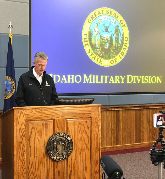 Idaho Gov. Brad Little issues a 21-day stay-at-home order to prevent the spread of the coronavirus from the Idaho Military Division headquarters in Boise, Idaho, on Wednesday, March 25, 2020. Idaho has more than 91 confirmed cases of COVID-19, the illness caused by the coronavirus, spread throughout the state. The governor also issued a new
