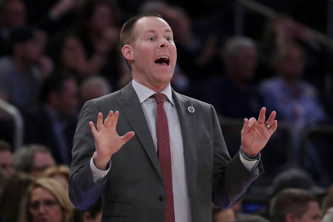 Xavier head coach Travis Steele talks to his team during the first half of an NCAA college basketball semifinal game against Villanova in the Big East men's tournament, Friday, March 15, 2019, in New York. (AP Photo/Julio Cortez)