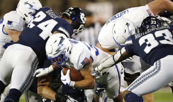 FILE--In this Saturday, Oct. 26, 2019, file photograph, Air Force fullback Taven Birdow, center, is stopped short of the end zone by Utah State defensive end Dalton Baker, left, and linebacker Kevin Meitzenheimer in the first half of an NCAA college football game at Air Force Academy, Colo. Birdow's father, Jermaine, was able to see in person for the first time his son play Saturday, Nov. 2, against Army. (AP Photo/David Zalubowski, File)