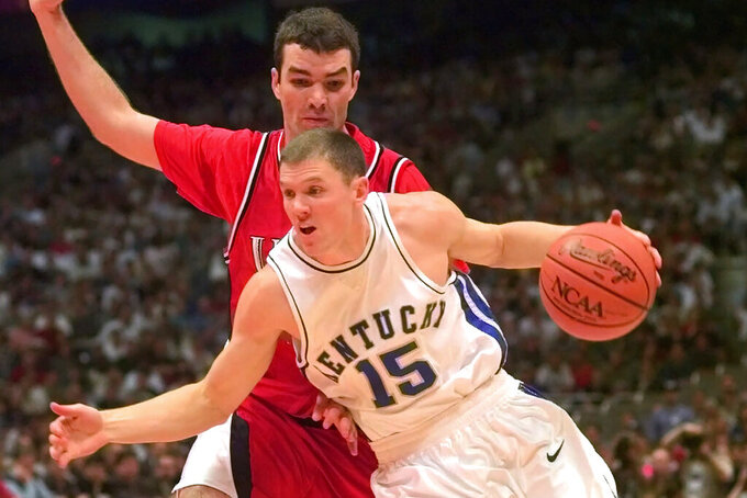 FILE - In this March 30, 1998, file photo, Kentucky's Jeff Sheppard (15) drives against Utah's Drew Hansen at the NCAA men's Final Four championship game in San Antonio. Kentucky defeated Utah 78-69. Sheppard works as a financial planner now and is over two decades removed from the time he helped Kentucky win the NCAA Tournament. Yet he still gets asked regularly about his role in the Wildcats' 1998 national championship. (AP Photo/Susan Ragan, File)