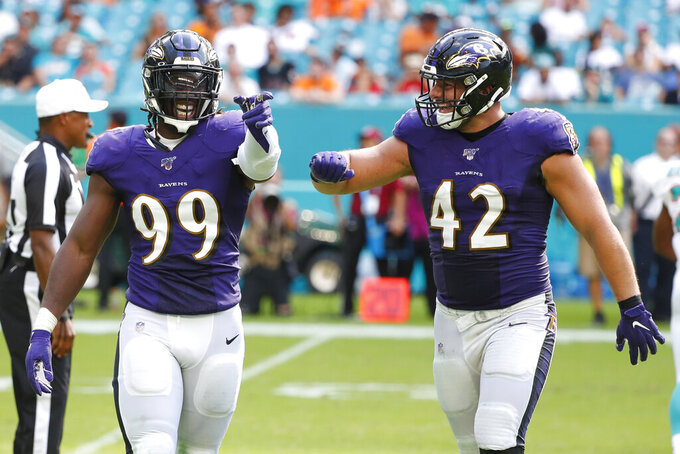 Baltimore Ravens outside linebacker Matt Judon (99) gestures to the team after sacking Miami Dolphins quarterback Josh Rosen, during the second half at an NFL football game, Sunday, Sept. 8, 2019, in Miami Gardens, Fla. To the right is Baltimore Ravens fullback Patrick Ricard (42). The Ravens defeated the Dolphins 59-10.(AP Photo/Wilfredo Lee)