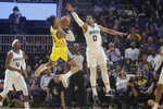 Golden State Warriors guard Jordan Poole, middle, shoots against Charlotte Hornets forward Miles Bridges (0) during the first half of an NBA basketball game in San Francisco, Saturday, Nov. 2, 2019. (AP Photo/Jeff Chiu)