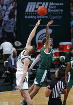 Michigan State's Thomas Kithier, left, and Eastern Michigan's Ty Groce leap for the tip to begin an NCAA college basketball game Wednesday, Nov. 25, 2020, in East Lansing, Mich. Michigan State won 83-67. (AP Photo/Al Goldis)
