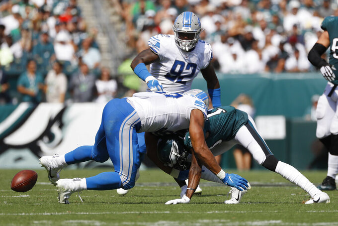 Philadelphia Eagles' Nelson Agholor, right, fumbles the ball against Detroit Lions' Trey Flowers during the first half of an NFL football game, Sunday, Sept. 22, 2019, in Philadelphia. (AP Photo/Michael Perez)