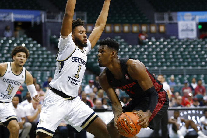 Georgia Tech forward James Banks III guards Houston center Chris Harris Jr., right, during the first half of an NCAA college basketball game Monday, Dec. 23, 2019, in Honolulu. (AP Photo/Marco Garcia)