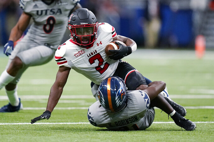 Lamar wide receiver James Jones (2) is stopped, after a catch, by UTSA cornerback Ken Robinson (21) during the first half of an NCAA college football game Saturday, Sept. 11, 2021, in San Antonio. (AP Photo/Eric Gay)