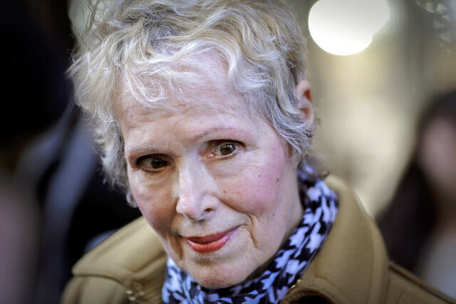"""FILE - In this March 4, 2020, photo, E. Jean Carroll talks to reporters outside a courthouse in New York. The U.S. Justice Department is seeking to take over President Donald Trump's defense in a defamation lawsuit brought by Carroll, who accused the president of raping her in a New York luxury department store in the mid-1990s. Federal lawyers asked a court Tuesday, Sept. 8, 2020, to allow a legal move that could put the American people on the hook for any money she might be awarded. She says the president's comments, including that she was """"totally lying"""" to sell a memoir, besmirched her character and harmed her career when he denied the rape allegations in 2019. (AP Photo/Seth Wenig, File)"""