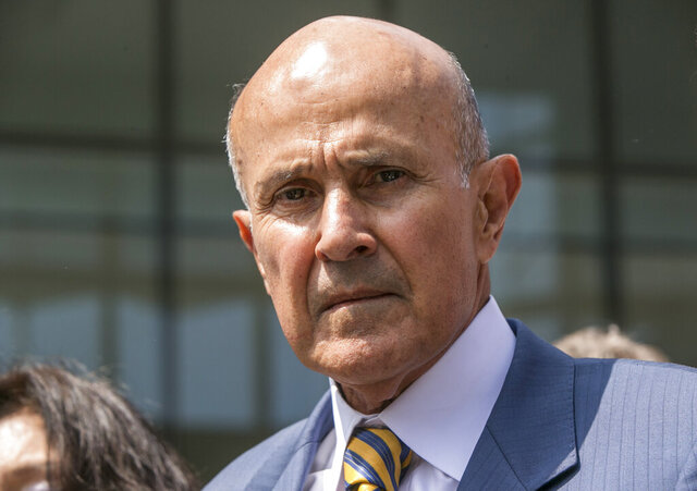 FILE - In this May 12, 2017, file photo, former Los Angeles County Sheriff Lee Baca leaves federal court in Los Angeles after he was sentenced to three years in prison for obstructing an FBI investigation into abuses at the jails he ran. Baca was ordered Thursday, Jan. 16, 2020, to report to prison by Feb. 5, 2020, to begin serving a three-year prison sentence for obstructing an FBI probe into corruption in the nation's largest sheriff's department. (AP Photo/Damian Dovarganes, File)