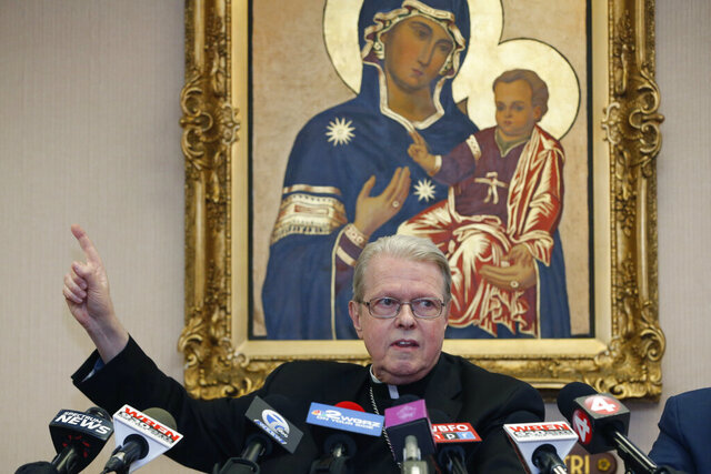 Bishop Edward Scharfenberger addresses the media, Friday, Feb. 28, 2018, in Buffalo N.Y., The Roman Catholic Diocese of Buffalo filed for bankruptcy protection Friday, taking another major step in its effort to recover from a clergy misconduct scandal that's been the basis for hundreds of lawsuits, Vatican intervention and resignation of its bishop. (AP Photo/Jeffrey T. Barnes)