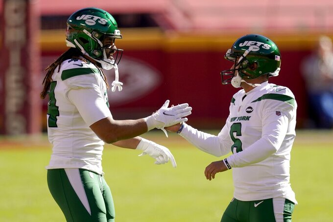 New York Jets' Harvey Langi (44) and Sergio Castillo (6) celebrate a field goal kicked by Castillo in the first half of an NFL football game against the Kansas City Chiefs on Sunday, Nov. 1, 2020, in Kansas City, Mo. (AP Photo/Charlie Riedel)