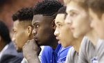 Duke's Zion Williamson watches from the bench during the first half of an NCAA college basketball game against Miami in Durham, N.C., Saturday, March 2, 2019. (AP Photo/Gerry Broome)